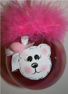 Handpainted Bear Christmas Ornament on an Pink Irredescent Christmas Ornament Accented with Pink Mirbeau feathers and a coordinating ribbon