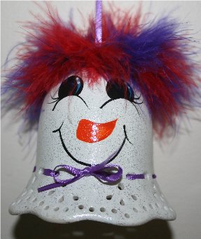 Handpainted Porcelin bells turned into a Red hat snowmen - each snowman ornamet has red/purple mirbeau feathers on top of her head and has a cheerful handpainted face, and is accented with a coordinating ribbon around her neck and is ready for hanging on your Christmas Tree
