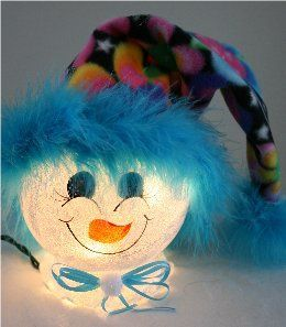 Handpainted Snowman Nightilght with Vibrant Flowered Fleece Hat and Bright Blue Mirbeau Feathers Surrounding her face